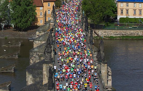 Runners crossing the river